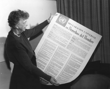 Eleanor Roosevelt holds a Spanish language version of the Universal Declaration of Human Rights